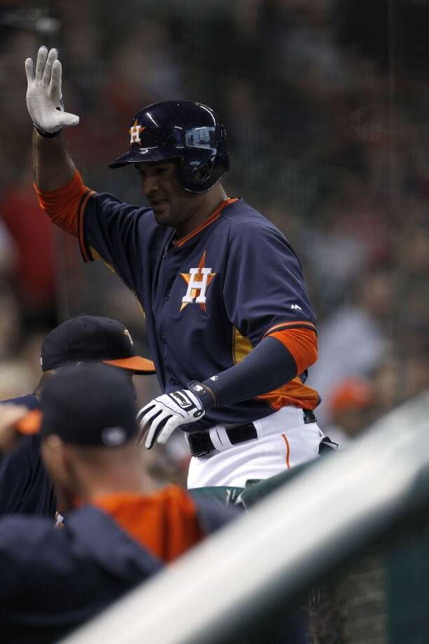 Jesus Guzman is congratulated by Astros teammates after hitting a home run versus the Angels. Photo: Karen Warren, Houston Chronicle