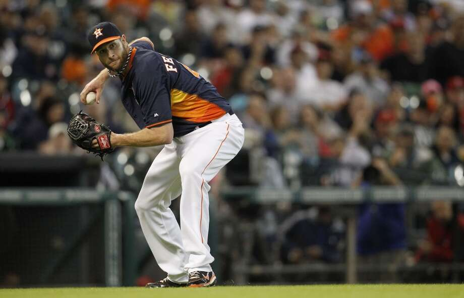 Astros pitcher Scott Feldman fields a ground ball against the Angels. Photo: Karen Warren, Houston Chronicle