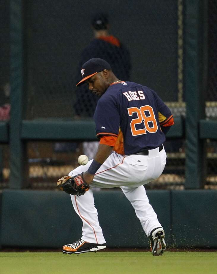 Astros outfielder L.J. Hoes looks to make a defensive play against the Angels. Photo: Karen Warren, Houston Chronicle