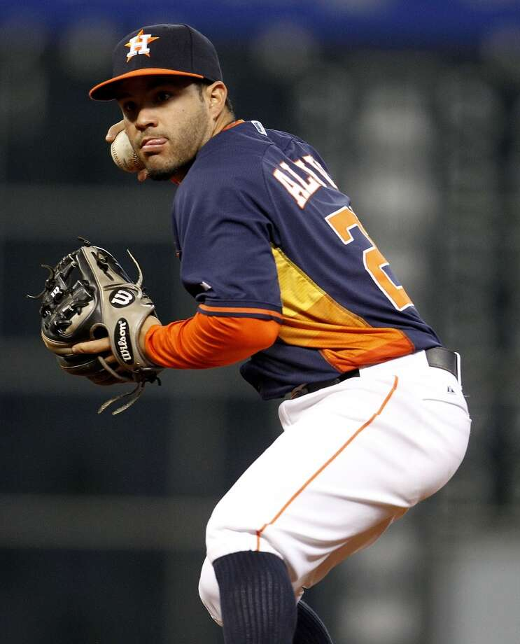 Astros second baseman Jose Altuve makes the throw to first for a ground out against the Angels. Photo: Karen Warren, Houston Chronicle
