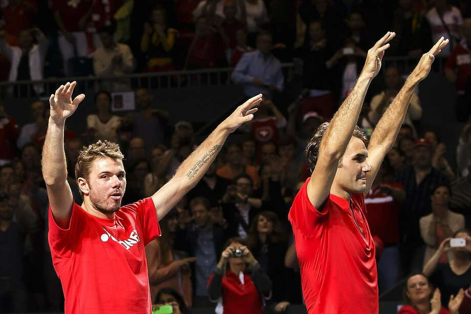 Switzerland's Stanislas Wawrinka (left) and Roger Federer survived Kazakhstan. Photo: Salvatore Di Nolfi, Associated Press