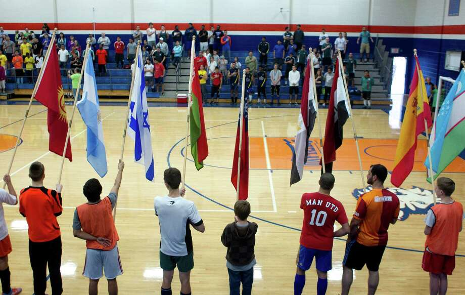 Flags representing many nations are held up as the United States National Anthem was performed during the opening ceremonies at the 5th annual Cup of Nations Soccer Tournament held at Houston Baptist University Saturday, April 5, 2014, in Houston. 