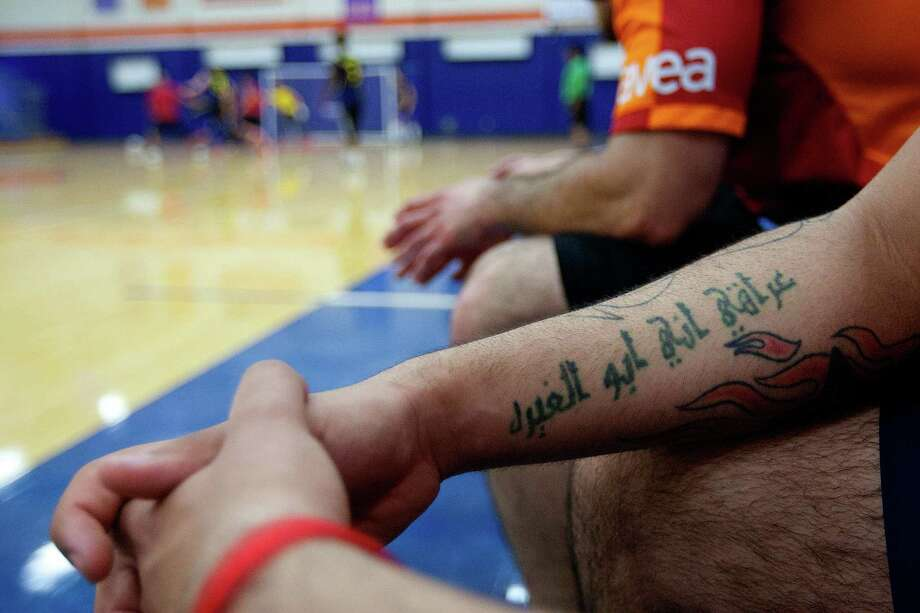 """""""Respect my country,"""" reads the tattoo on the arm of Mohammed Alqaisi, 18, an immigrant from Iraq, who has been in the U.S. for five years as he watched the 5th annual Cup of Nations Soccer Tournament held at Houston Baptist University Saturday, April 5, 2014, in Houston.  More than 12 nations were represented at the tournament that encouraged, sport, togetherness and equality. Photo: Johnny Hanson, Houston Chronicle / © 2014  Houston Chronicle"""