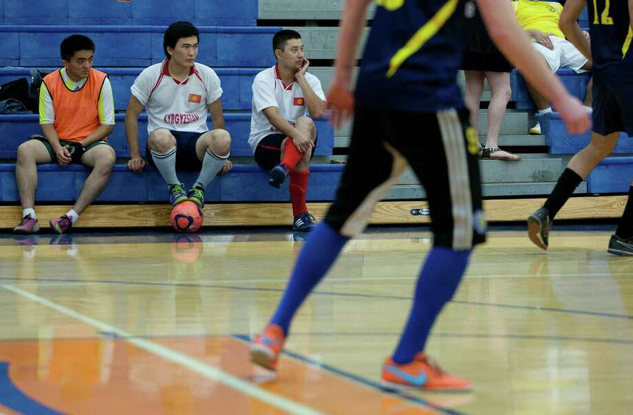 At left, Talant Mamyrkanov, 22, Arzybek Priev, 20, and Kanat Eraliev, 28, of Kyrgyzstan look on from the bleachers during the 5th annual Cup of Nations Soccer Tournament held at Houston Baptist University Saturday, April 5, 2014, in Houston.  More than 12 nations were represented at the tournament that encouraged, sport, togetherness and equality. Photo: Johnny Hanson, Houston Chronicle / © 2014  Houston Chronicle