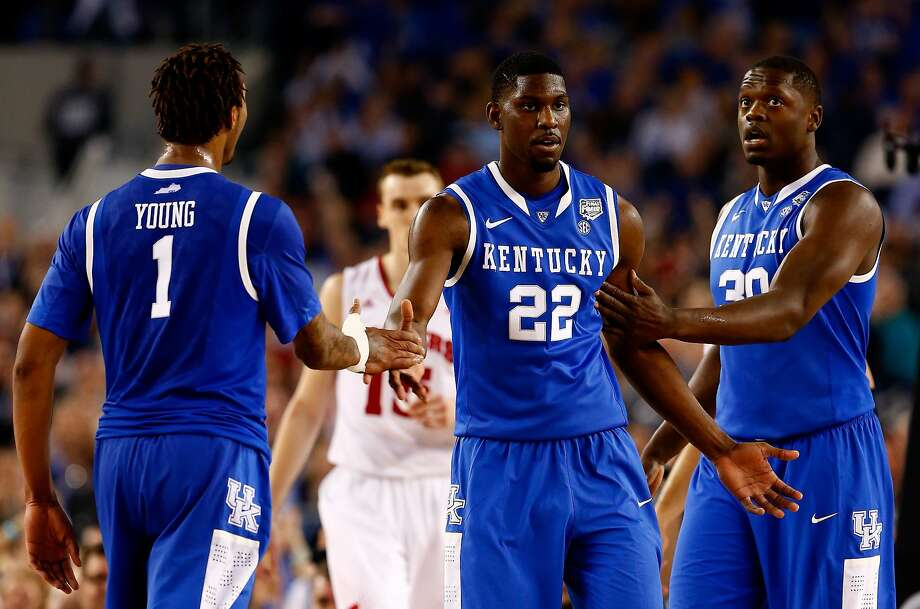 Alex Poythress (22) and Kentucky freshmen James Young and Julius Randle. Photo: Tom Pennington, Getty Images