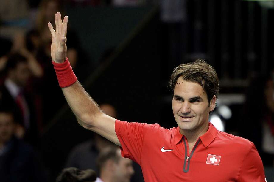 Switzerland's Roger Federer reacts after he defeated Kazakhstan's Mikhail Kukushkin in his Davis Cup World Group quarter-final match, on April 4, 2013 in Geneva. AFP PHOTO / FABRICE COFFRINIFABRICE COFFRINI/AFP/Getty Images Photo: FABRICE COFFRINI / AFP