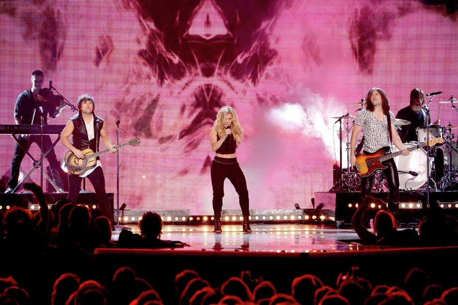 LAS VEGAS, NV - APRIL 06:  (L-R) Musicians Neil Perry, Kimberly Perry and Reid Perry of The Band Perry perform onstage during the 49th Annual Academy Of Country Music Awards at the MGM Grand Garden Arena on April 6, 2014 in Las Vegas, Nevada. Photo: Ethan Miller, Getty Images / 2014 Getty Images