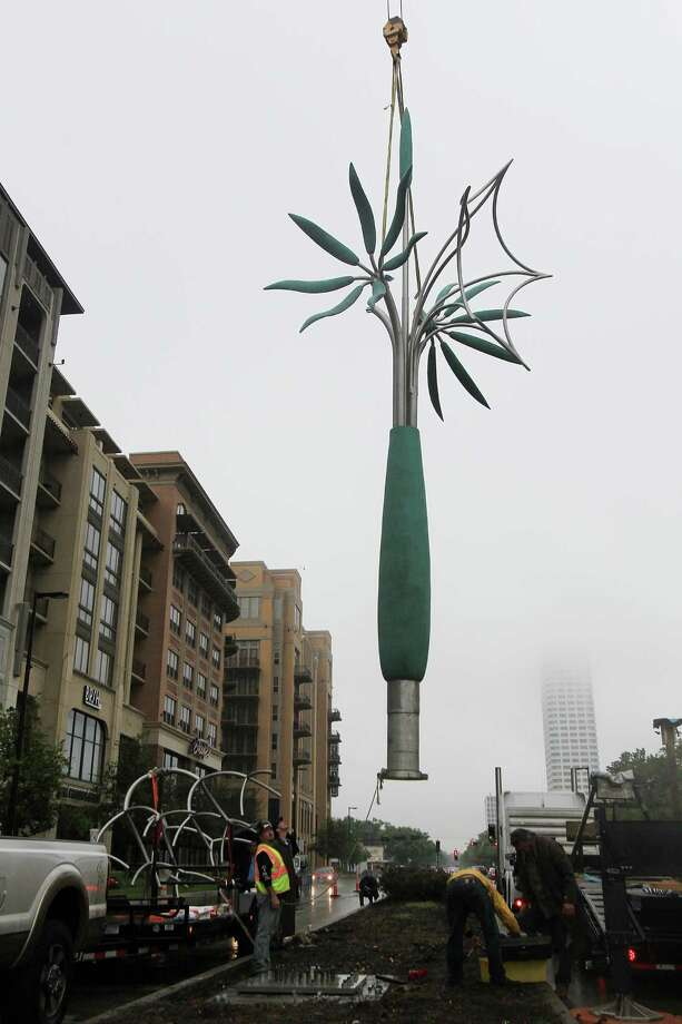 "Sculptor James Surls installs his new bronze and stainless steel sculpture ""Tree and Tree Flowers,"" which stands taller than 35 feet when installed Sunday on Kirby Boulevard. Photo: Mayra Beltran, Staff / © 2014 Houston Chronicle"