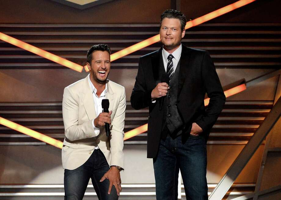 LAS VEGAS, NV - APRIL 06:  Co-hosts Luke Bryan (L) and Blake Shelton speak onstage during the 49th Annual Academy Of Country Music Awards at the MGM Grand Garden Arena on April 6, 2014 in Las Vegas, Nevada. Photo: Ethan Miller, Getty Images / 2014 Getty Images
