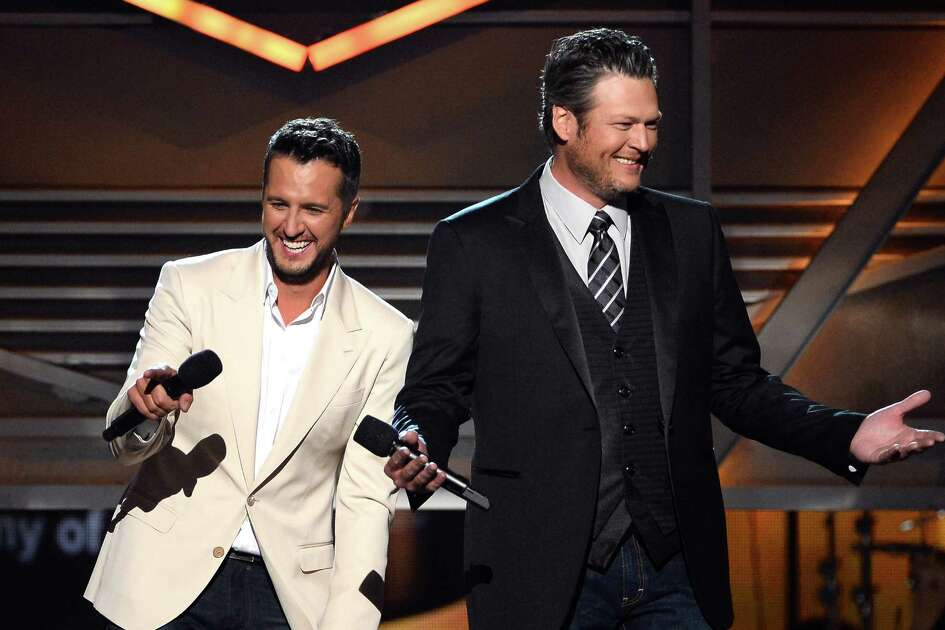 LAS VEGAS, NV - APRIL 06: Co-hosts Luke Bryan (L) and Blake Shelton speak onstage during the 49th Annual Academy Of Country Music Awards at the MGM Grand Garden Arena on April 6, 2014 in Las Vegas, Nevada.