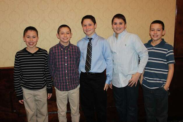 Members of the Guilderland Pop Warner squad were among those recognized at the Little SCholars Luncheon last month. From left, Jacob Govel, Logan Neimeyer, Hunter Griffith, Nicolas Popolizio and Jason Kiernan. Not pictured are Brody Daniels, Michael Gitto, John Malone and Samuel Smith. (Submitted photo)
