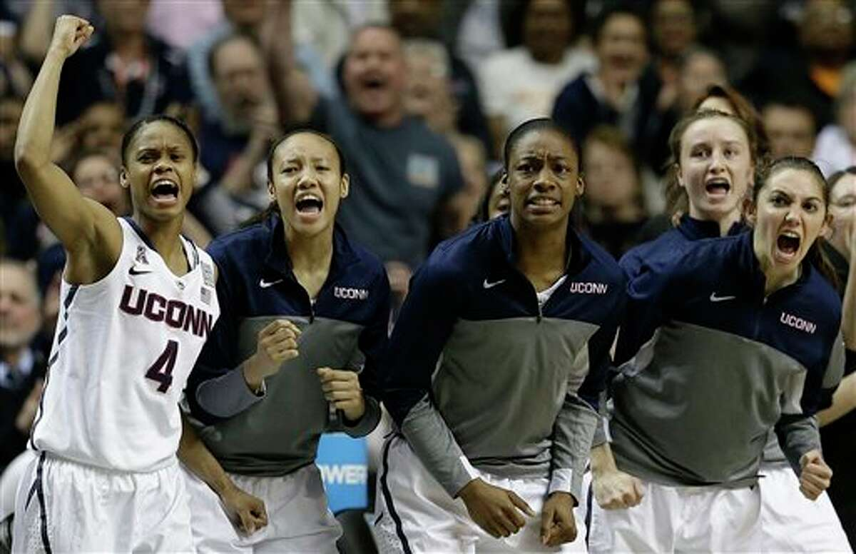 The Connecticut bench cheers a basket against Stanford during the first half of the semifinal game in the Final Four of the NCAA women's college basketball tournament, Sunday, April 6, 2014, in Nashville, Tenn. (AP Photo/Mark Humphrey)