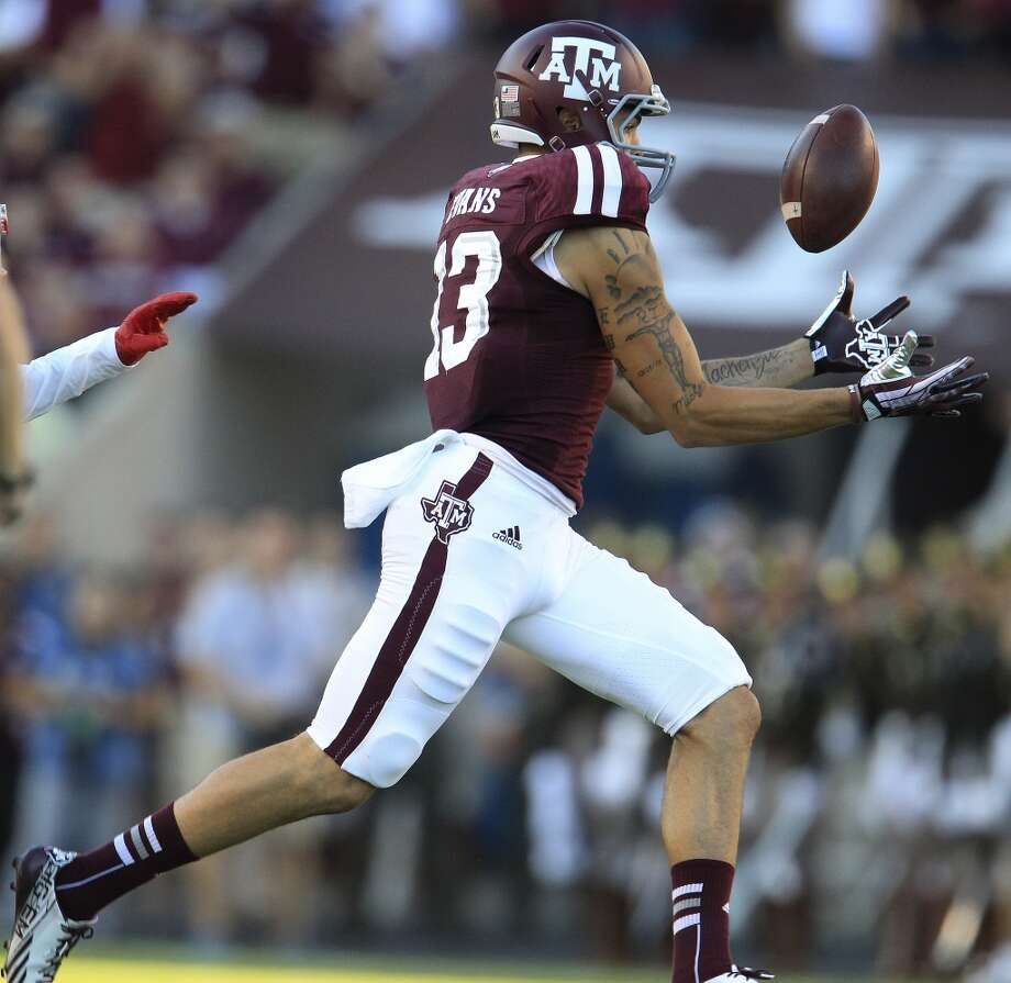 7. Tampa Bay: Mike Evans, WR, Texas A&M.  After trading Mike Williams, they'll jump on the No. 2 receiver.  Mock 1: Greg Robinson, OT, Auburn. Photo: Karen Warren, Houston Chronicle