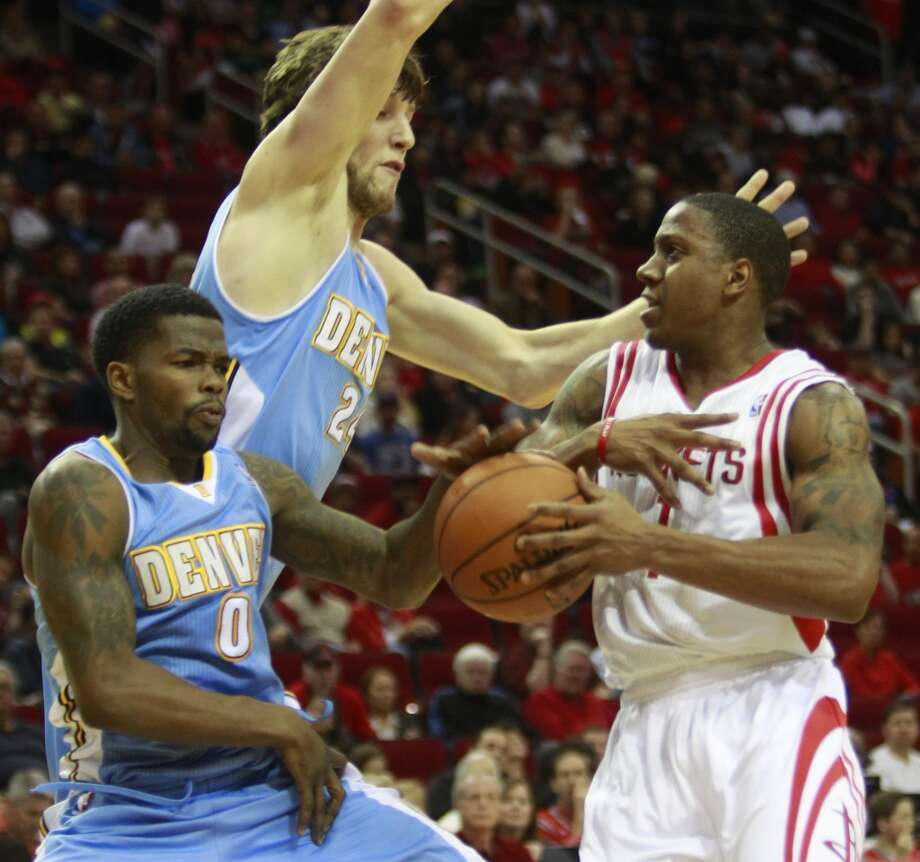 Isaish Canaan, right, is fouled by Aaron Brooks. Photo: Melissa Phillip, Houston Chronicle