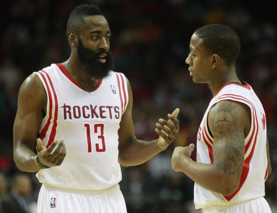 James Harden talks with Isaiah Canaan as he reacts to his shot not beating the first-quarter buzzer. Photo: Melissa Phillip, Houston Chronicle