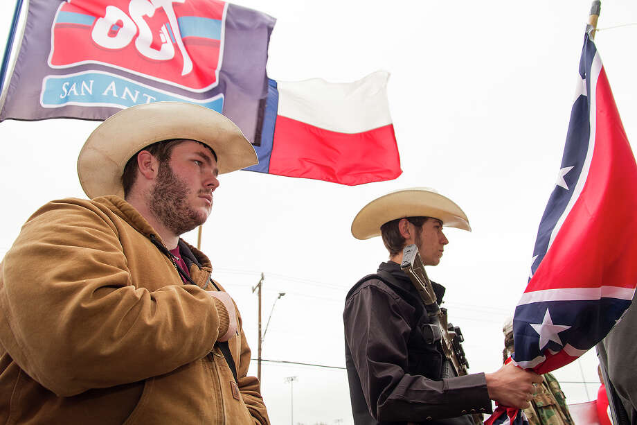 (Left to right) Michael Moody and Mason Deering at a rally in support of Henry Vichique, Sunday, April 6, 2014, at the San Antonio Police Department West Substation by Open Carry Texas. 19 year-old Vichique was tased and arrested on March 31, 2014 while walking home with a loaded rifle. Photo: Photo By Alma E. Hernandez / For The San
