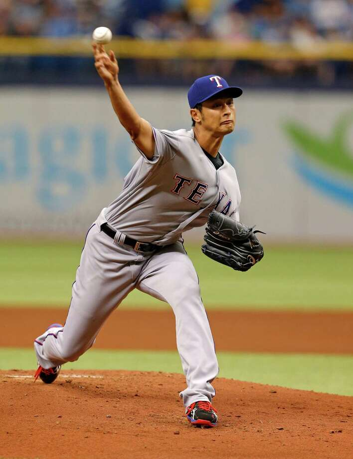 Texas Rangers starting pitcher Yu Darvish throws during the first inning of a baseball game against the Tampa Bay Rays, Sunday, April 6, 2014, in St. Petersburg, Fla. (AP Photo/Mike Carlson) ORG XMIT: FLMC103 Photo: Mike Carlson / FR155492 AP