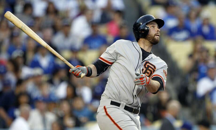San Francisco Giants' Brandon Belt watches his solo home run in the sixth inning of a baseball game against the Los Angeles Dodgers on Sunday, April 6, 2014, in Los Angeles. He has already hit 5 home runs this season. Photo: Alex Gallardo, Associated Press