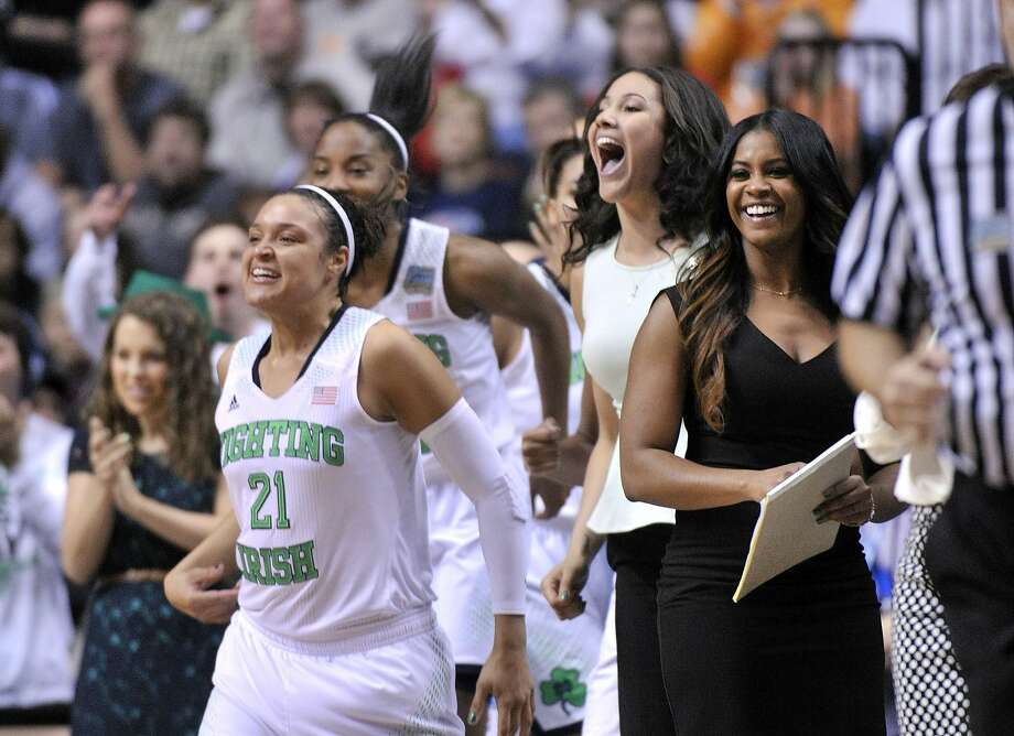 Kayla McBride and her Notre Dame teammates celebrate after the Irish overwhelmed Maryland. Photo: Jim Brown, Reuters