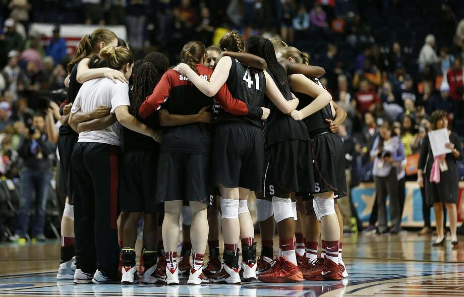 The Stanford women's basketball team huddles at the end of its loss to Connecticut in the Final Four. Photo: John Bazemore, Associated Press