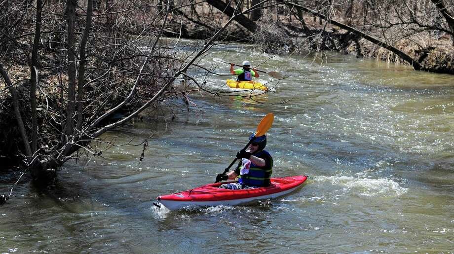 Kayakers make their way down the river during the 41st Tenandeho Whitewater Derby on Sunday, April 6, 2014, in Mechanicville, N.Y.  (Paul Buckowski / Times Union) Photo: Paul Buckowski / 00026213A