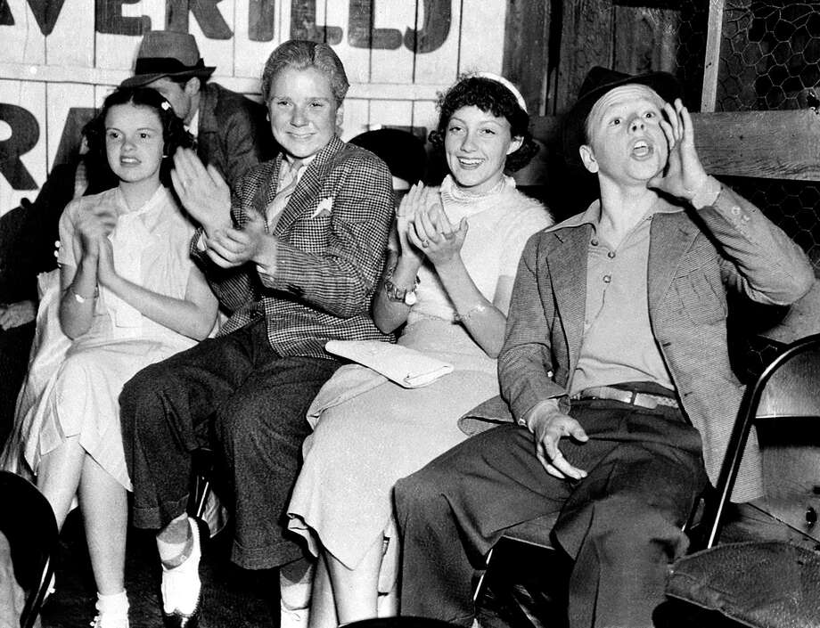 Judy Garland, Jackie Cooper, Diane Lewis and Mickey Rooney, from left to right, attend a ball game in Hollywood, Ca., on July 24, 1936. Photo: (AP Photo)