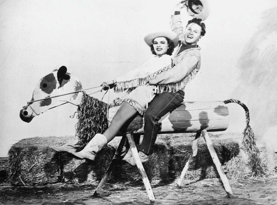 """Musical comedy stars Judy Garland and Mickey Rooney performing in this photo from the 1943 movie musical, """"Girl Crazy"""".Actor Mickey Rooney died Sunday, April 6, 2014, at age 93. Photo: (AP Photo)"""