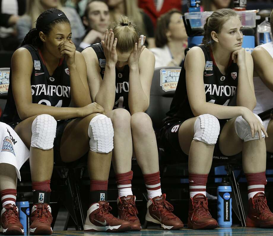 Stanford's Erica McCall, Taylor Greenfield and Karlie Samuelson, from left, sit on the bench  during the second half of the semifinal game against Connecticut in the Final Four of the NCAA women's college basketball tournament, Sunday, April 6, 2014, in Nashville, Tenn. Connecticut won 75.56. (AP Photo/Mark Humphrey) Photo: Mark Humphrey, Associated Press