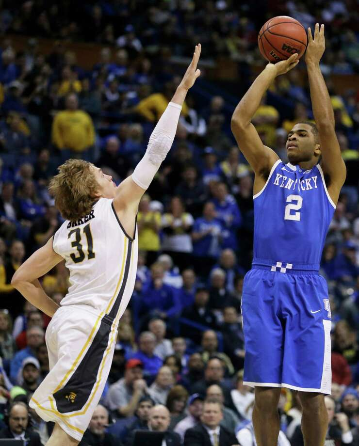 If either team is in need of a game-winning shot during tonight's national championship game, Kentucky's Aaron Harrison (2) and Connecticut's Shabazz Napier (13) are more than capable of answering the call. Photo: Jeff Roberson, STF / AP