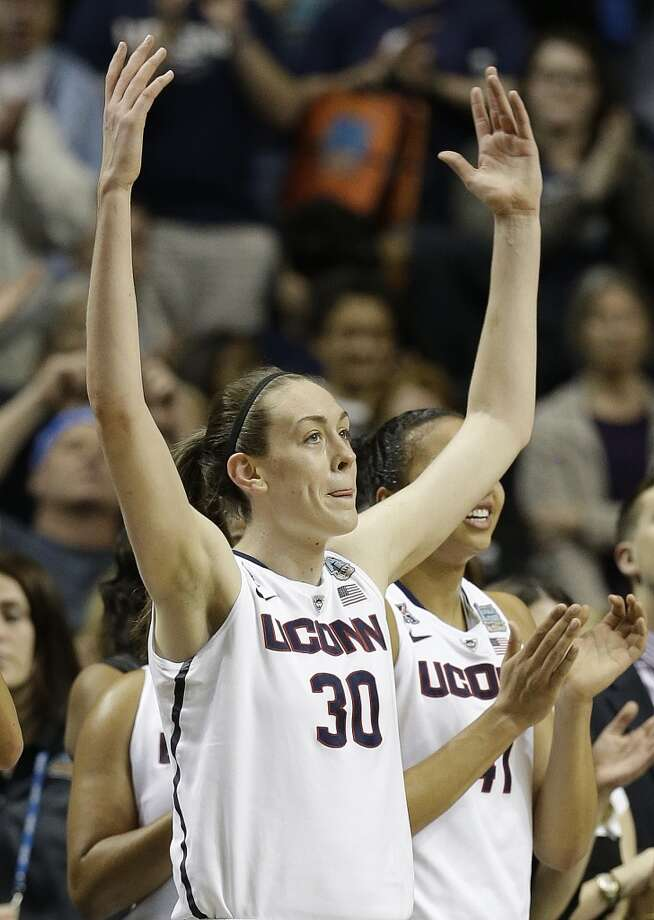 Connecticut forward Breanna Stewart (30) celebrates during the second half of the semifinal game against Stanford in the Final Four of the NCAA women's college basketball tournament, Sunday, April 6, 2014, in Nashville, Tenn. Connecticut won 75.56. (AP Photo/Mark Humphrey) Photo: AP
