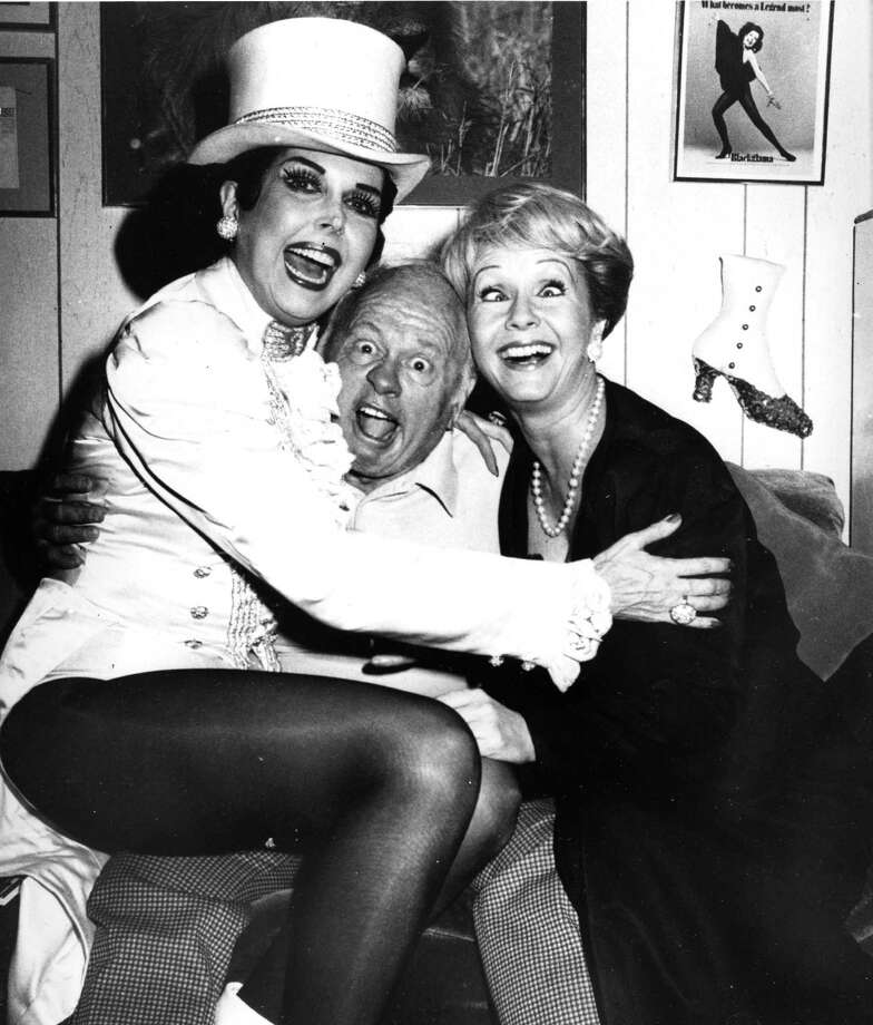 "Actress Debbie Reynolds, right, clowns around with ""Sugar Babies"" cast members Ann Miller, left, and Mickey Rooney backstage at New York's Mark Hellinger Theatre, in this Sept. 5, 1980 file photo. Miller, the raven-haired, long-legged actress and dancer whose machine-gun taps won her stardom during the golden age of movie musicals, died Thursday, Jan. 22, 2004 of lung cancer. She was 81. Photo: AP / AP"