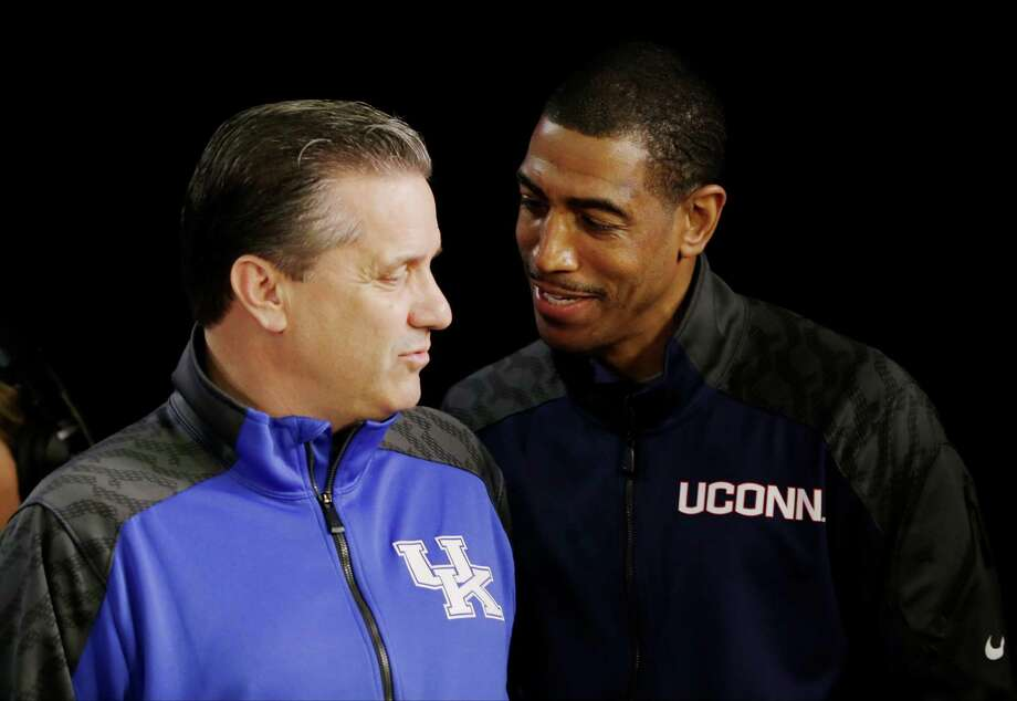 Connecticut head coach Kevin Ollie and Kentucky head coach John Calipari talk during a television interview for the NCAA Final Four tournament college basketball championship game Sunday, April 6, 2014, in Arlington, Texas. Connecticut plays Kentucky in the championship game on Monday, April 7. 2014. (AP Photo/David J. Phillip)  ORG XMIT: FF133 Photo: David J. Phillip / AP