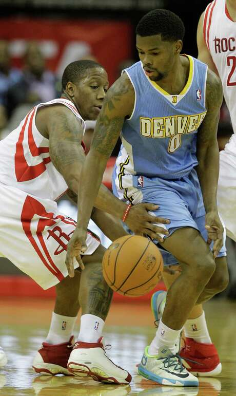 The Rockets' Isaiah Canaan, left, tries to disrupt Aaron Brooks, who flirted with a triple-double. Photo: Melissa Phillip, Staff / © 2014  Houston Chronicle