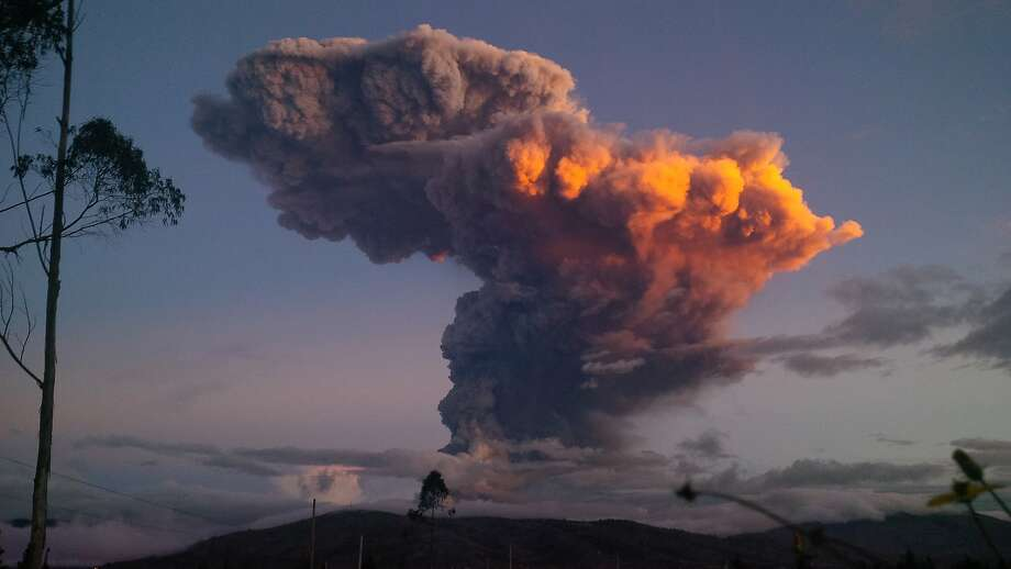 In this Friday, April 4, 2014 photo, the Tungurahua volcano spews a column of ash as seen from Ambato, Ecuador. The volcano spewed a miles high column of ash after a powerful explosion that shot pyroclastic material onto its northern and northwestern flanks. (AP Photo) Photo: Associated Press