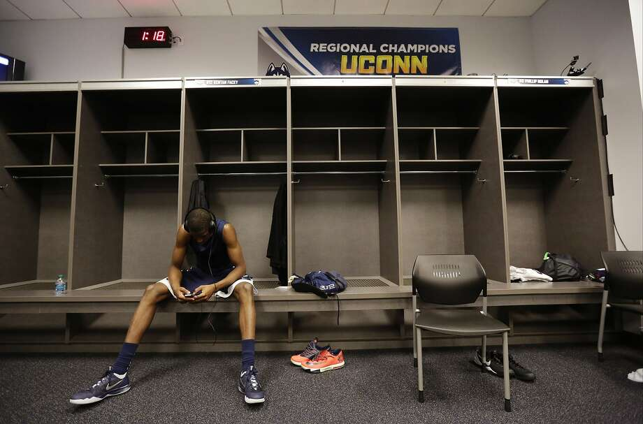 Connecticut forward Kentan Facey relaxes in the locker room before practice the NCAA Final Four tournament college basketball championship game Sunday, April 6, 2014, in Arlington, Texas. Connecticut plays Kentucky in the championship game on Monday, April 7. 2014. (AP Photo/Eric Gay) Photo: Eric Gay, Associated Press