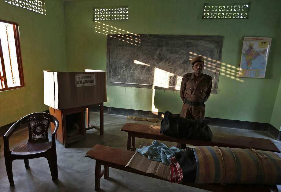 A policeman stands guard over an Electronic Voting Machine (EVM) at a polling booth ahead of the general elections in Majuli, a large river island in the Brahmaputra river, Jorhat district, in the northeastern Indian state of Assam April 6, 2014. India, the world's largest democracy, will hold its general election in nine stages staggered between April 7 and May 12. REUTERS/Adnan Abidi (INDIA - Tags: POLITICS ELECTIONS) Photo: Adnan Abidi, Reuters