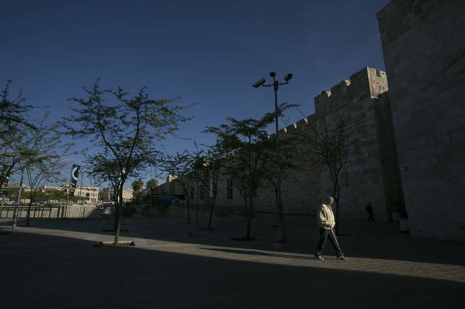 A man walks near Jaffa Gate in Jerusalem's old city April 6, 2014. REUTERS/Baz Ratner (JERUSALEM - Tags: SOCIETY CITYSCAPE) Photo: Baz Ratner, Reuters