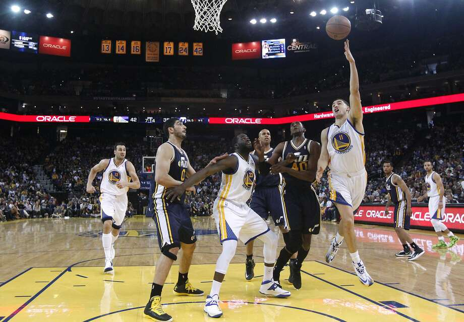 Klay Thompson, who had a game-high 33 points, puts up a shot in the first half. Thompson sank 7 of 10 three-point attempts and scored just over a point a minute. He and backcourt mate Stephen Curry combined for 64 points. Photo: Marcio Jose Sanchez, Associated Press