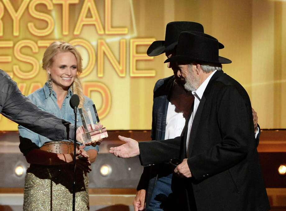 LAS VEGAS, NV - APRIL 06:  Singer/songwriter Merle Haggard (R) accepts the ACM Crystal Milestone Award from (L-R) singer/songwriters Miranda Lambert and George Strait onstage during the 49th Annual Academy Of Country Music Awards at the MGM Grand Garden Arena on April 6, 2014 in Las Vegas, Nevada. Photo: Ethan Miller, Getty Images / 2014 Getty Images