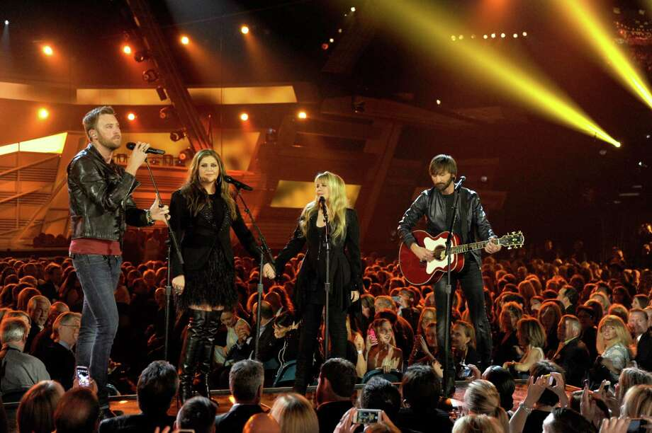 LAS VEGAS, NV - APRIL 06:  Singer Stevie Nicks (2nd L) performs with singers (L-R) Charles Kelley, Hillary Scott and Dave Haywood of Lady Antebellum onstage during the 49th Annual Academy Of Country Music Awards at the MGM Grand Garden Arena on April 6, 2014 in Las Vegas, Nevada. Photo: Ethan Miller, Getty Images / 2014 Getty Images