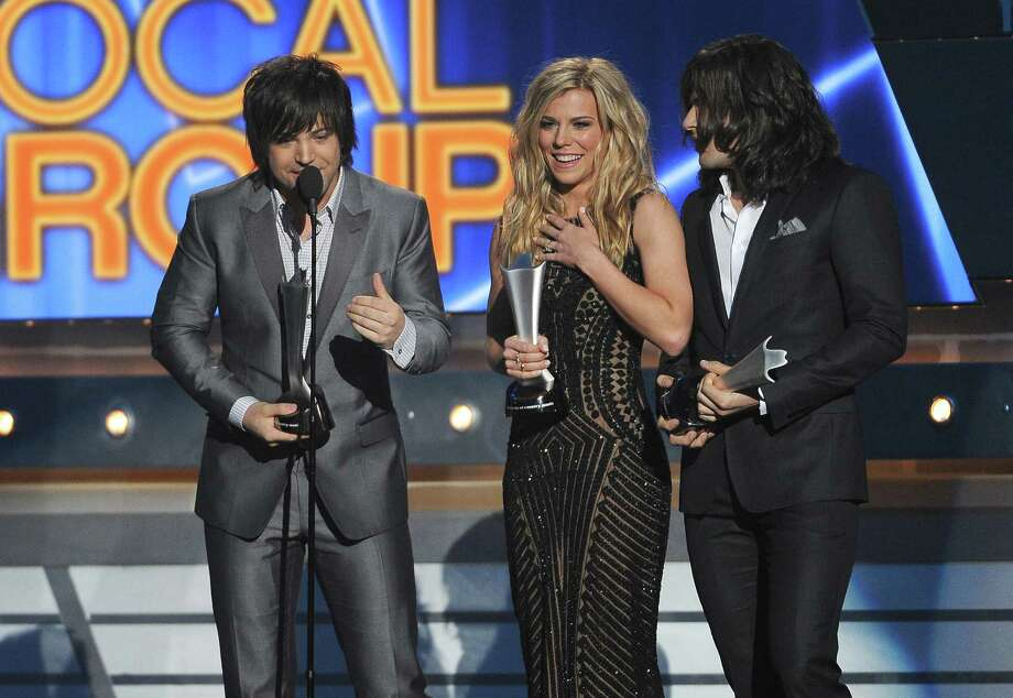Neil Perry and from left, Kimberly Perry and Reid Perry, of the musical group The Band Perry, accept the award for vocal group of the year at the 49th annual Academy of Country Music Awards at the MGM Grand Garden Arena on Sunday, April 6, 2014, in Las Vegas. (Photo by Chris Pizzello/Invision/AP) Photo: Chris Pizzello, Associated Press / Invision
