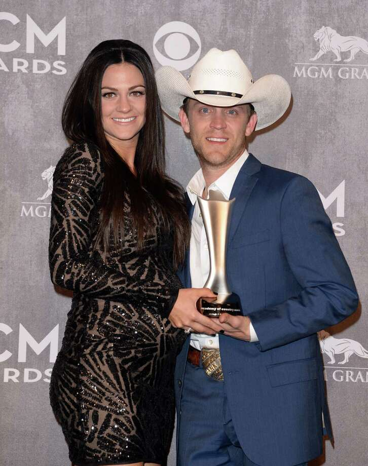 LAS VEGAS, NV - APRIL 06:  Musician Justin Moore (R) and Kate Moore pose in the press room with the Best New Artist award during the 49th Annual Academy Of Country Music Awards at the MGM Grand Garden Arena on April 6, 2014 in Las Vegas, Nevada. Photo: Jason Merritt, Getty Images / 2014 Getty Images
