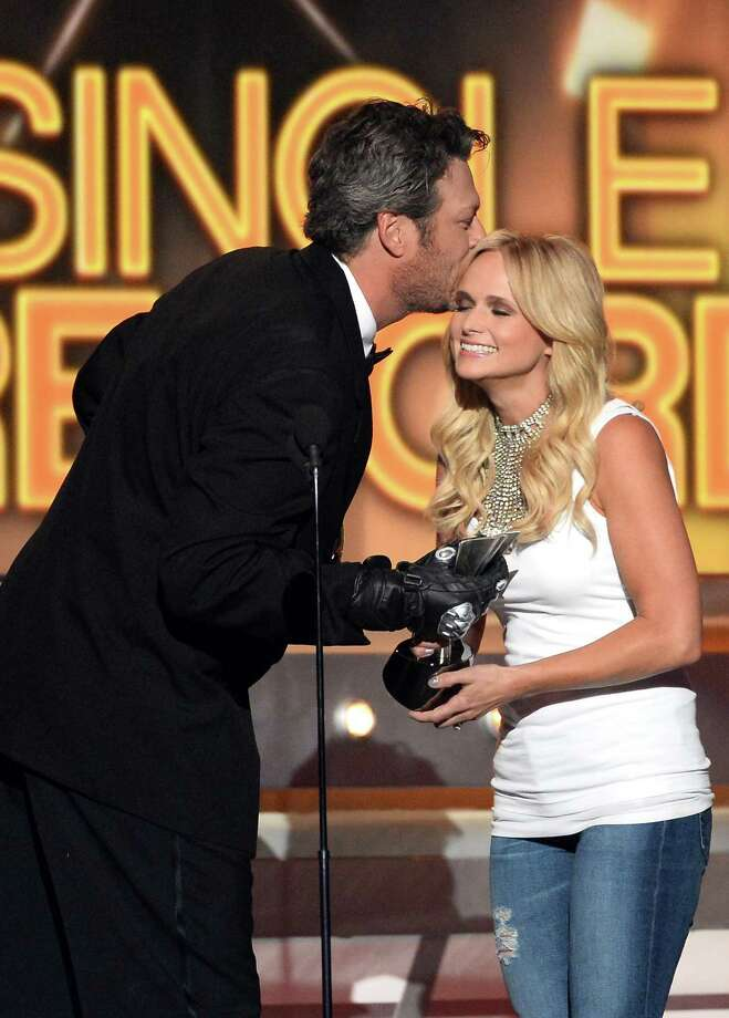 LAS VEGAS, NV - APRIL 06:  Singer Miranda Lambert (R) accepts the Single Record of the Year award for 'Mama's Broken Heart' onstage from host Blake Shelton during the 49th Annual Academy Of Country Music Awards at the MGM Grand Garden Arena on April 6, 2014 in Las Vegas, Nevada. Photo: Ethan Miller, Getty Images / 2014 Getty Images