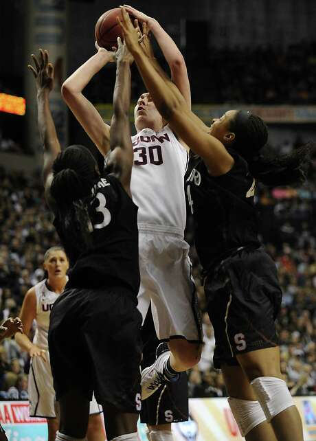 Double-teamed all game, Connecticut's Breanna Stewart (30) was just too tall an order for Stanford. Photo: John Woike, MBR / Hartford Courant