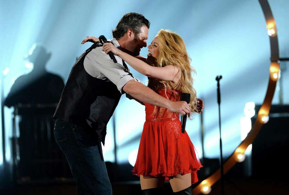LAS VEGAS, NV - APRIL 06:  Musicians Blake Shelton (L) and Sharkira perform onstage during the 49th Annual Academy Of Country Music Awards at the MGM Grand Garden Arena on April 6, 2014 in Las Vegas, Nevada. Photo: Ethan Miller, Getty Images / 2014 Getty Images