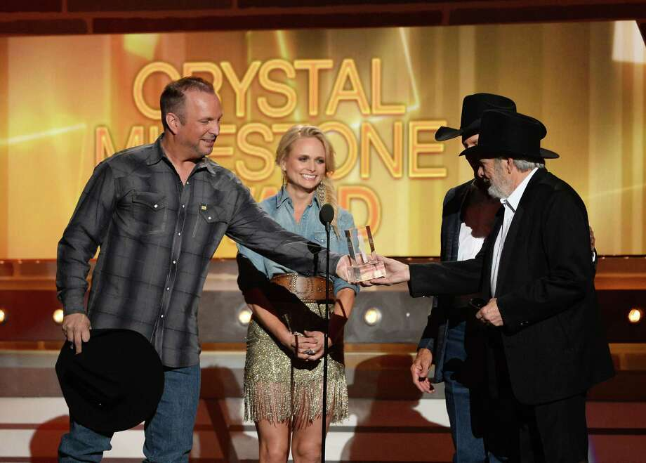 LAS VEGAS, NV - APRIL 06:  Singer/songwriter Merle Haggard (R) accepts the ACM Crystal Milestone Award from (L-R) singer/songwriters Garth Brooks, Miranda Lambert and George Strait onstage during the 49th Annual Academy Of Country Music Awards at the MGM Grand Garden Arena on April 6, 2014 in Las Vegas, Nevada. Photo: Ethan Miller, Getty Images / 2014 Getty Images