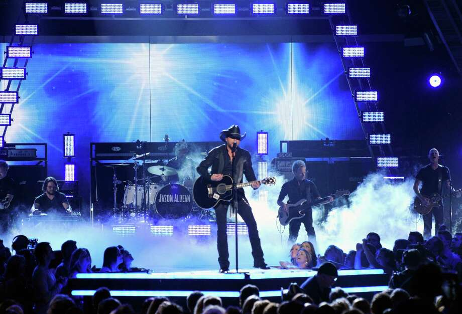 LAS VEGAS, NV - APRIL 06:  Singer Jason Aldean performs onstage during the 49th Annual Academy Of Country Music Awards at the MGM Grand Garden Arena on April 6, 2014 in Las Vegas, Nevada.  (Photo by Ethan Miller/Getty Images) Photo: Ethan Miller, Staff / 2014 Getty Images