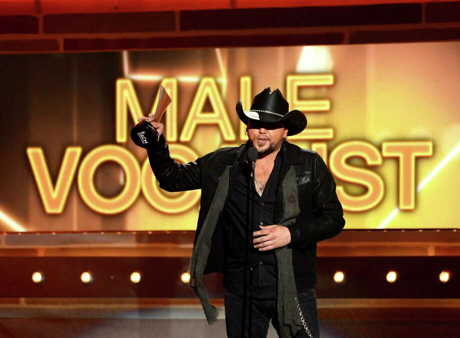 LAS VEGAS, NV - APRIL 06:  Singer Jason Aldean accepts the Male Vocalist of the Year award onstage during the 49th Annual Academy Of Country Music Awards at the MGM Grand Garden Arena on April 6, 2014 in Las Vegas, Nevada. Photo: Ethan Miller, Getty Images / 2014 Getty Images
