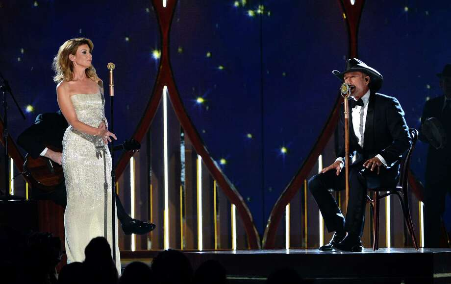 LAS VEGAS, NV - APRIL 06:  Singers Faith Hill (L) and Tim McGraw perform onstage during the 49th Annual Academy Of Country Music Awards at the MGM Grand Garden Arena on April 6, 2014 in Las Vegas, Nevada. Photo: Ethan Miller, Getty Images / 2014 Getty Images