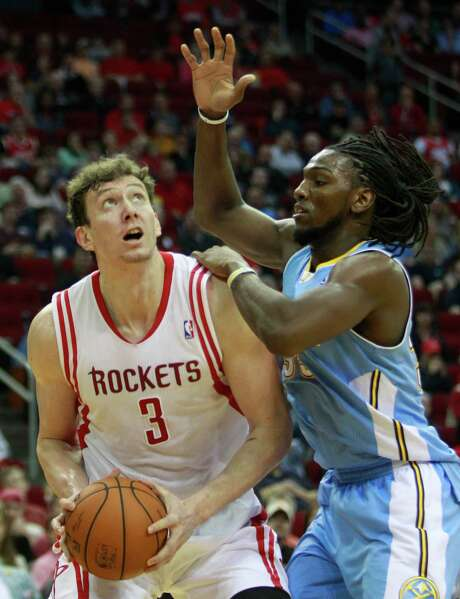 Rockets center Omer Asik, left, had 18 points on 6-for-11 shooting against Kenneth Faried and the Nuggets in an OT win Sunday night. Photo: Melissa Phillip, Staff / © 2014  Houston Chronicle